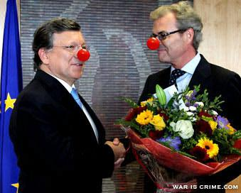 European Commission President Jose Manuel Barroso, left, receives flowers from Norway's ambassador to the EU Atle Leikvoll, after the 2012 Nobel Peace Prize was given to the EU, at the European Commission headquarters in Brussels, on Oct. 12, 2012.