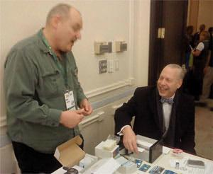 Jeffrey Tucker making a Shire Silver card with help from the company's founder, Ron Helwig.